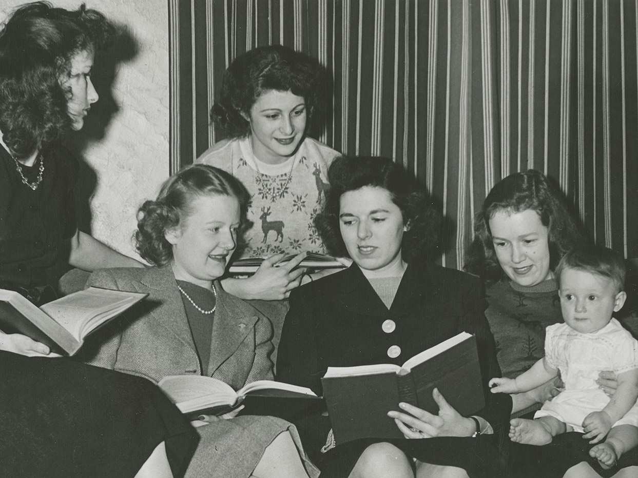 Five female students studying with infant