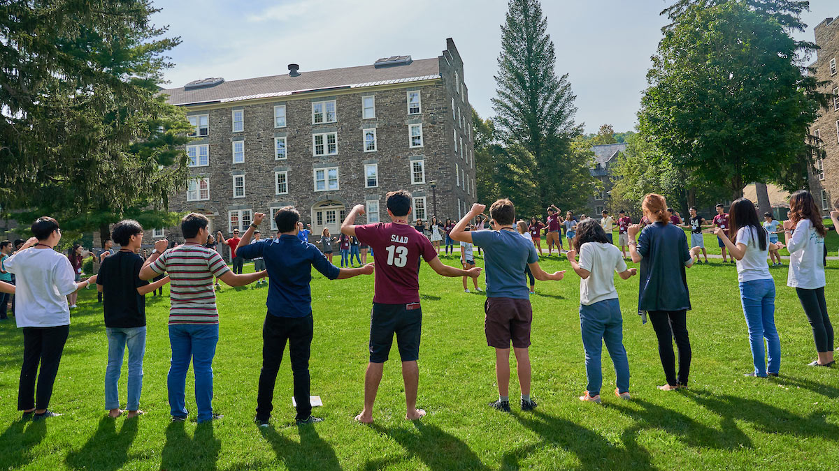 International students join hands on the academic quad