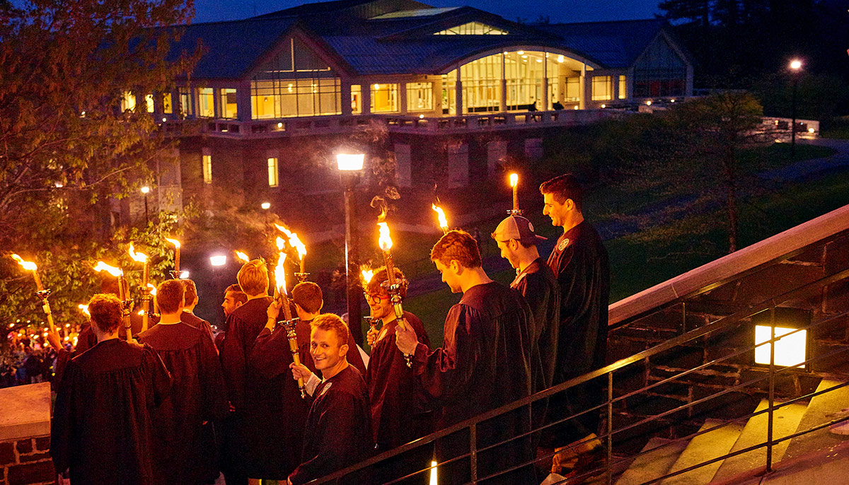 Students descend the Person steps during the Torchlight ceremony