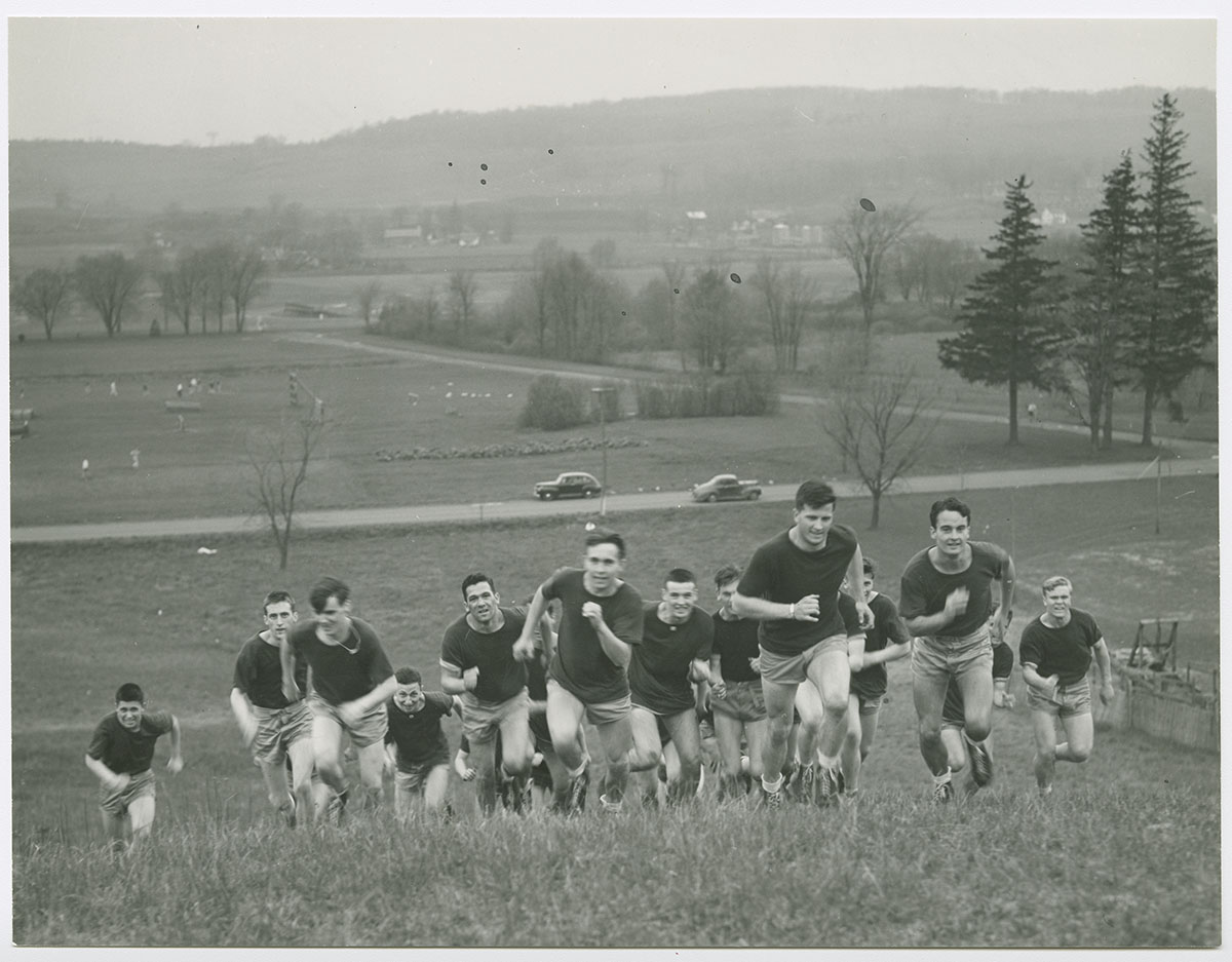 "Bill Geyer, Class of 1942, leads cadets up the ski slope, dubbed ""Agony Hill,"" 1943"