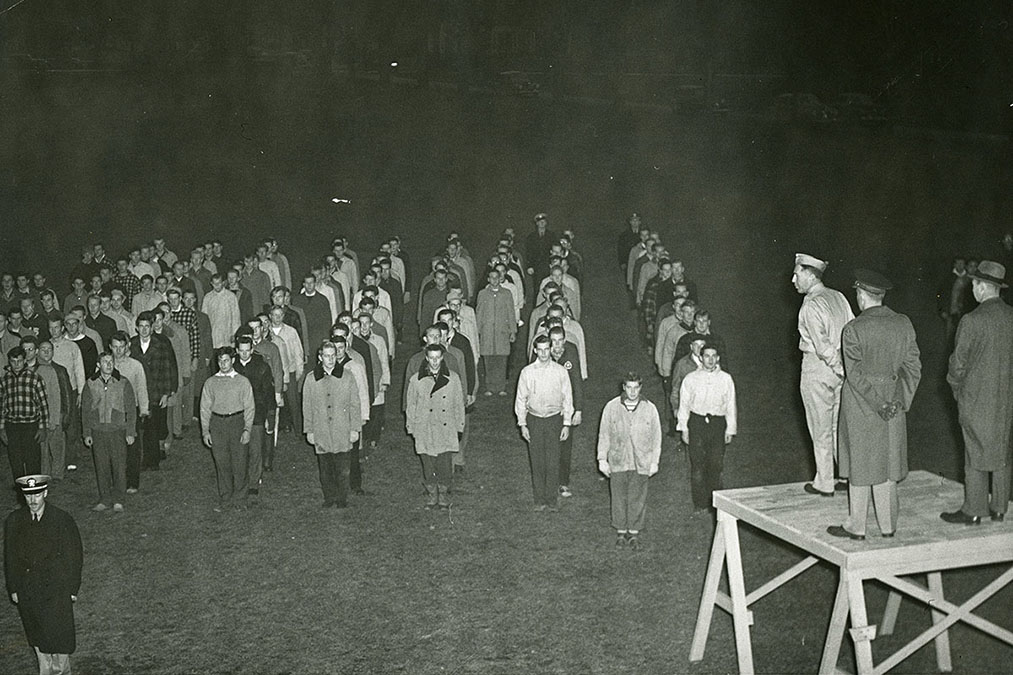 Student Corps dressed warmly for early morning drills on Whitnall Field, 1942