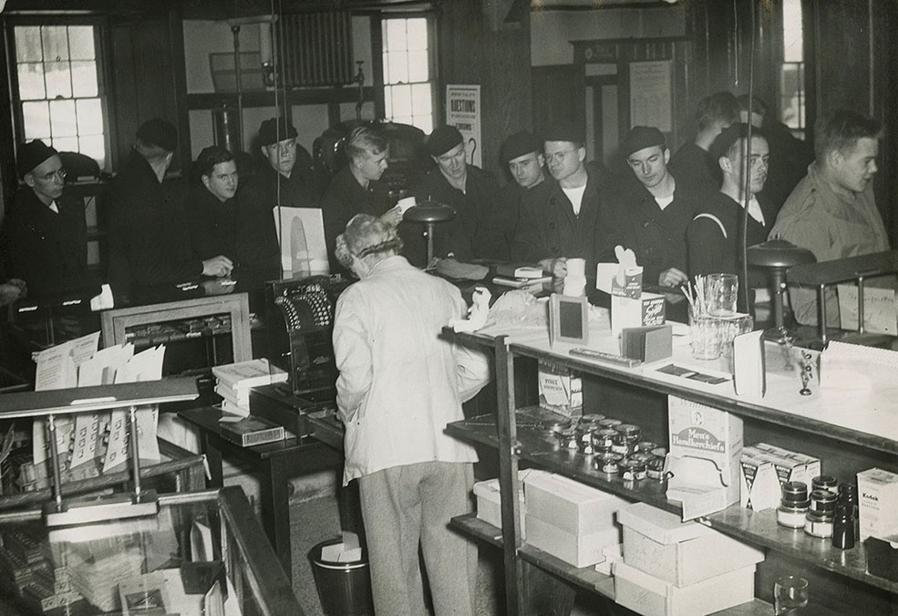 Cadets browse merchandise at campus store in East Hall, 1945