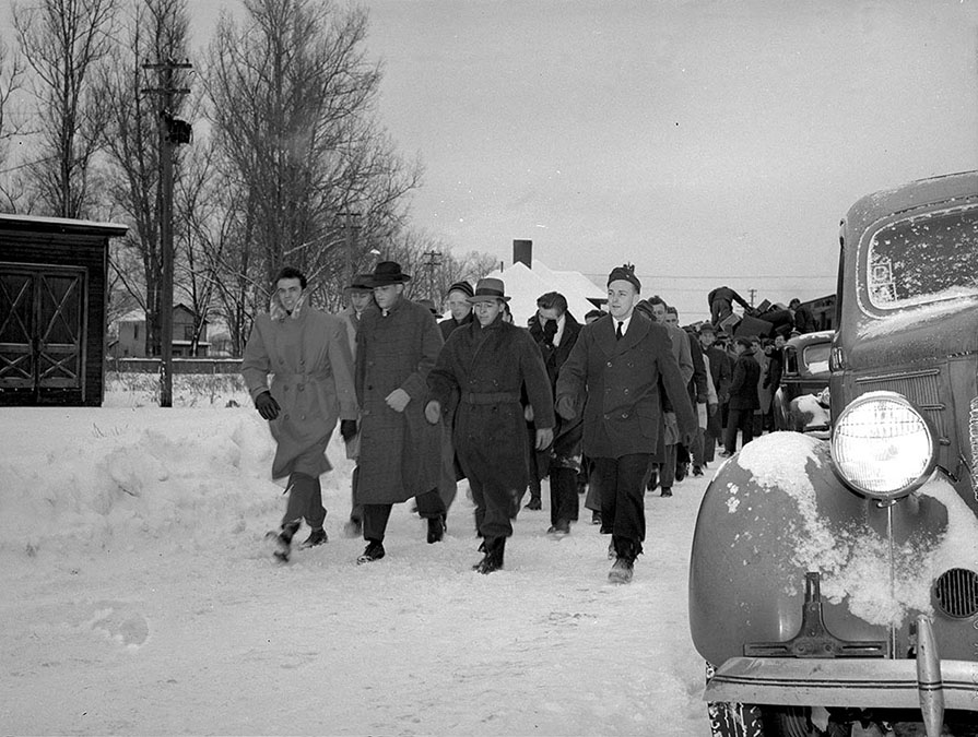 Navy Flight Preparatory School cadets arrive at Hamilton train station during snowstorm, 1943