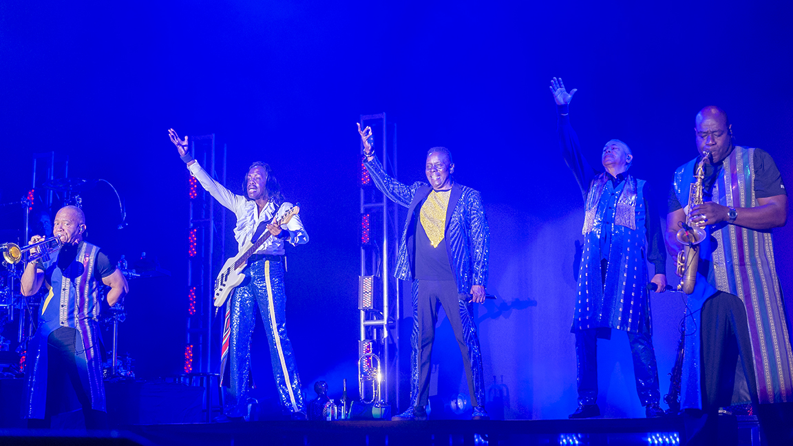Earth, Wind & Fire band members wave to crowd