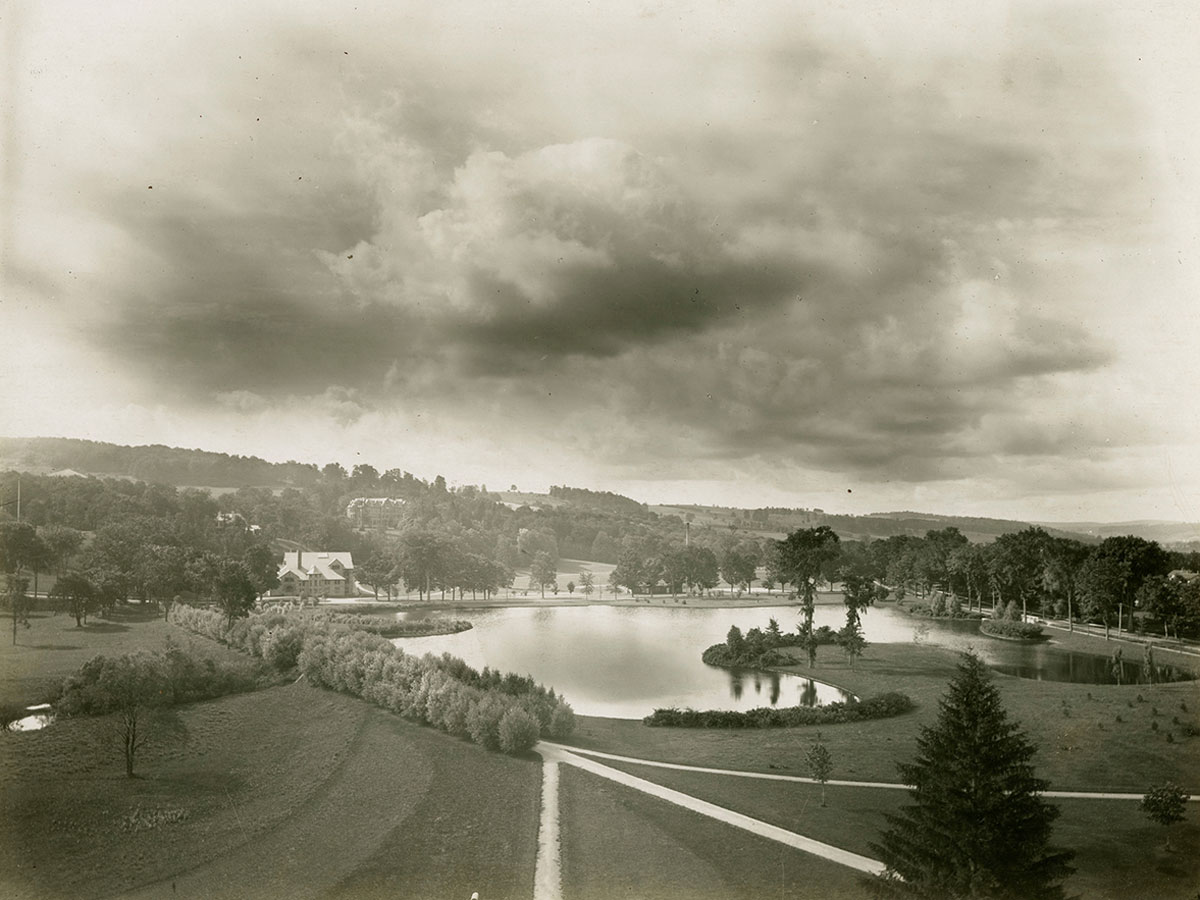 Black and white archival image of Willow Path and Taylor lake, with Eaton Hall visible in the distance.