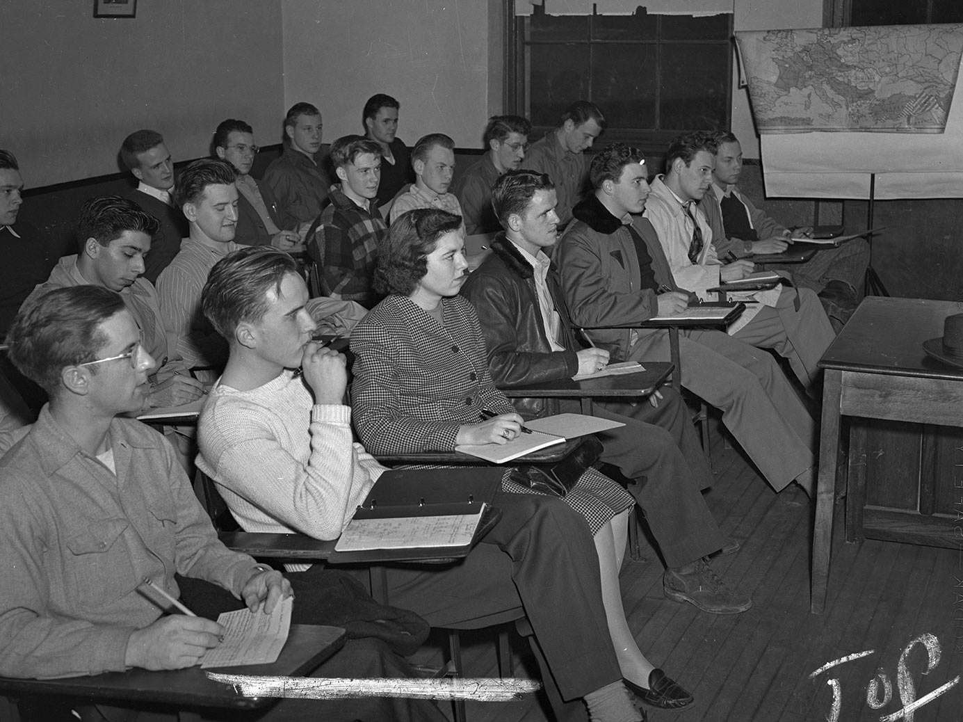 Vintage photo of classroom with Helen Craven Mues as the only female student