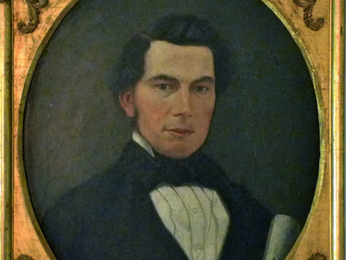 A framed portrait of George Gavin Ritchie