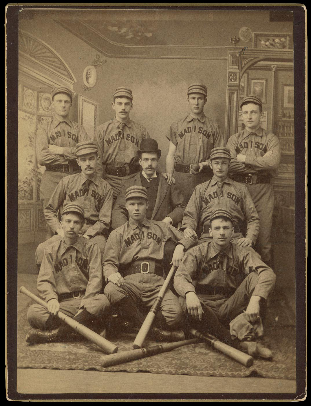 Archival image of students in baseball uniforms