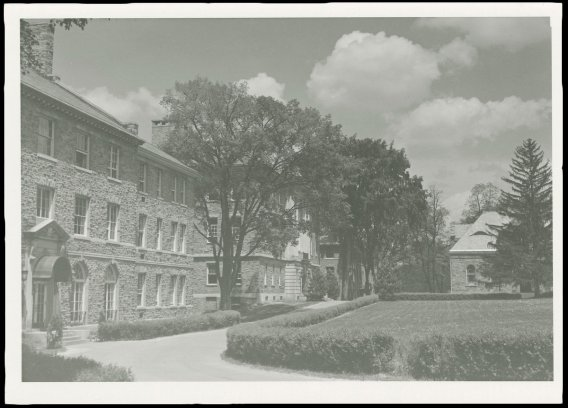An archival image of the Academic Quad, with Lawrence Hall, Lathrop Hall, and Hascall Hall visible