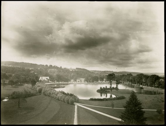 Archival image of Colgate's lower campus, with Willow Path in the foreground, and Taylor Lake in the background.